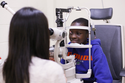 Young child receiving eye care.