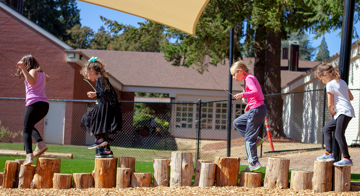 ELC students practice their balance in the Brim Family Outdoor Learning Center.