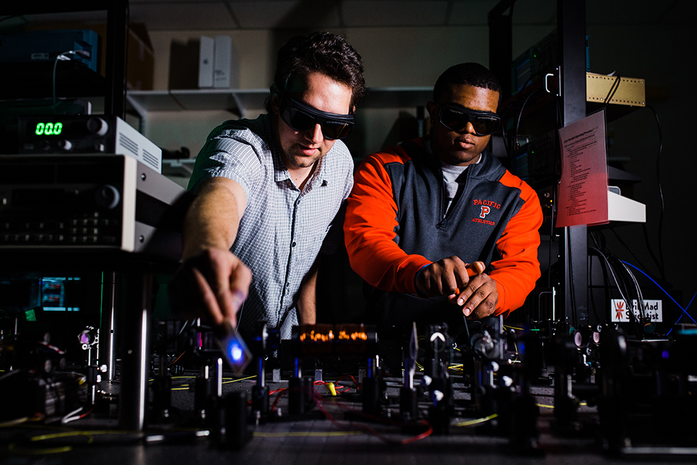 Andy Dawes and Kevin McGee '18 in the laser lab