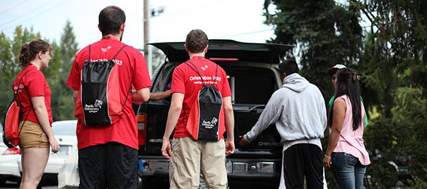 Student Volunteers Unloading a Car