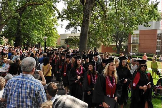 students walking at graduation
