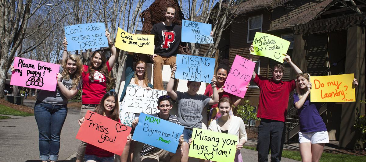 students with signs for their parents