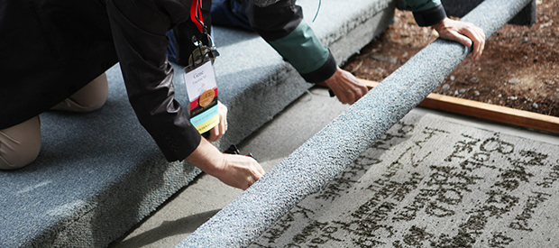 Signing concrete outside Old College Hall