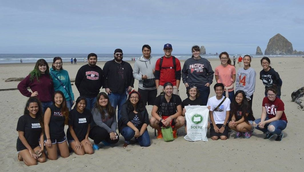 Pacific students participate in a SOLVE beach clean-up.