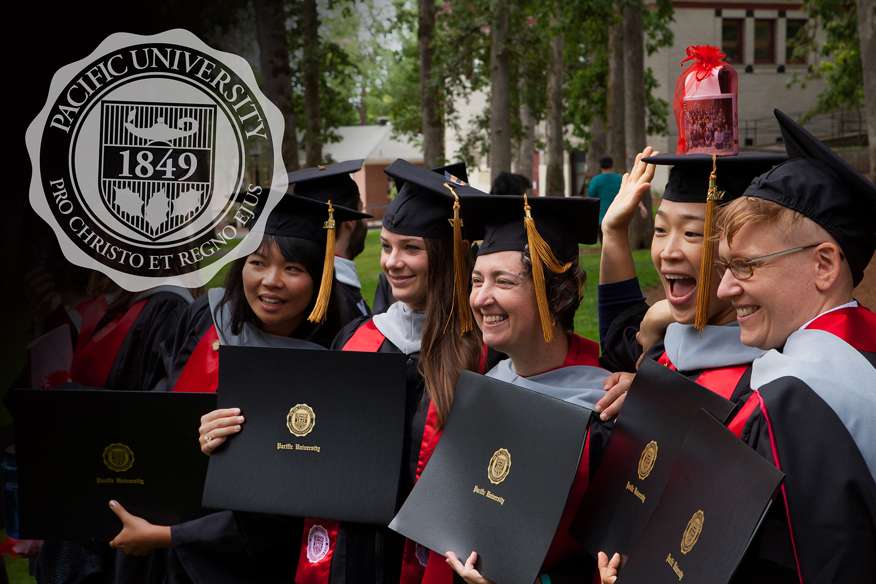 University Seal overlay on a group of happy grads holding diplomas with the seal