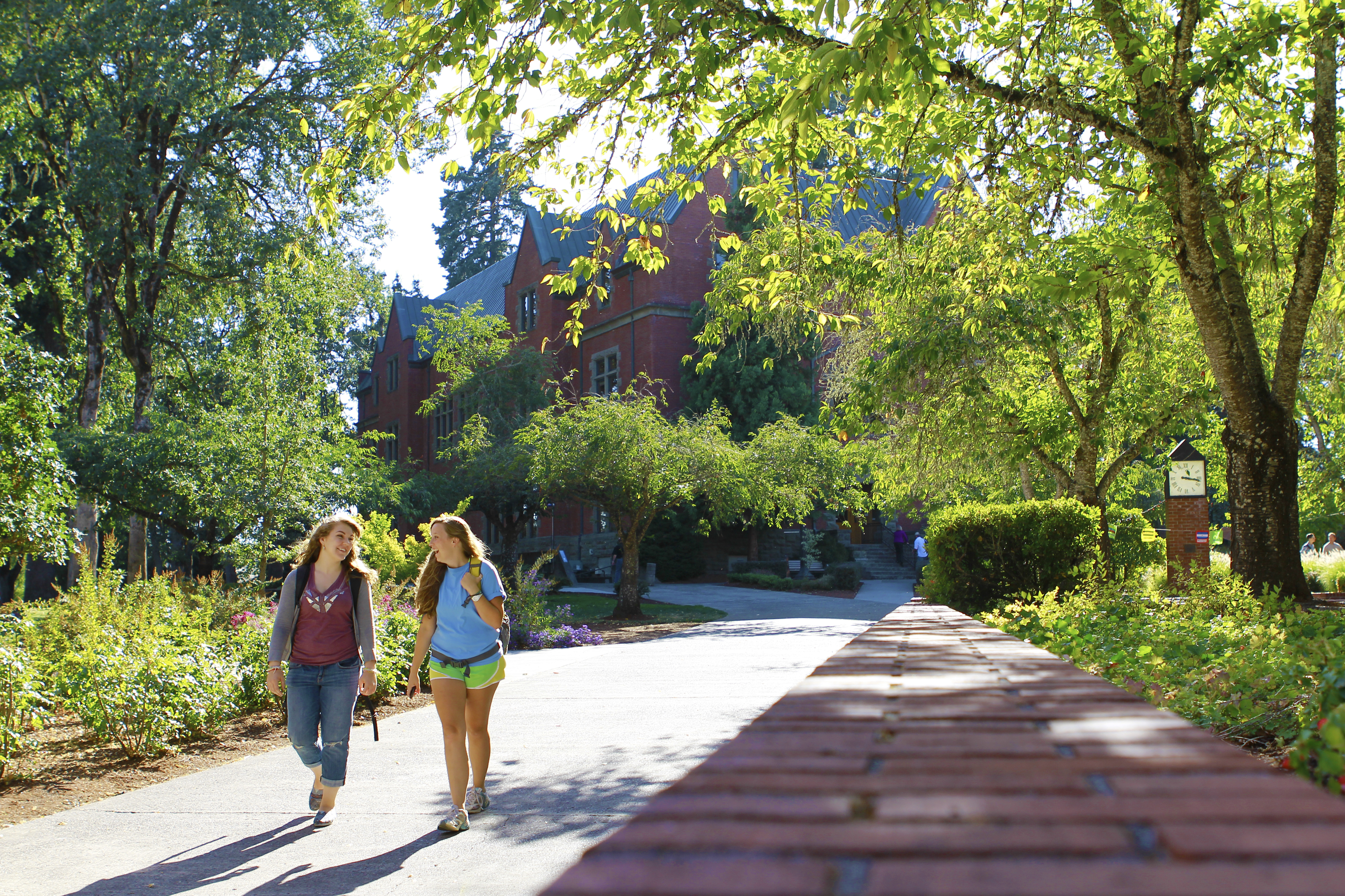 Two female students walking down pathway on Forest Grove Campus