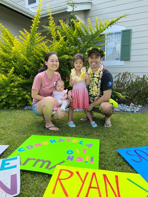 Ryan Moore '07, PT '10 with wife Erin Tagami '08, PT '11 and their two children