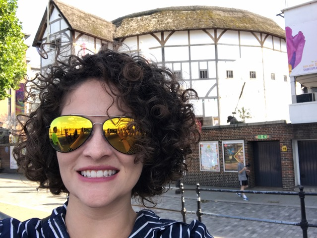 Photograph of Dr. Tavares in front of Shakespeare's Globe in London.