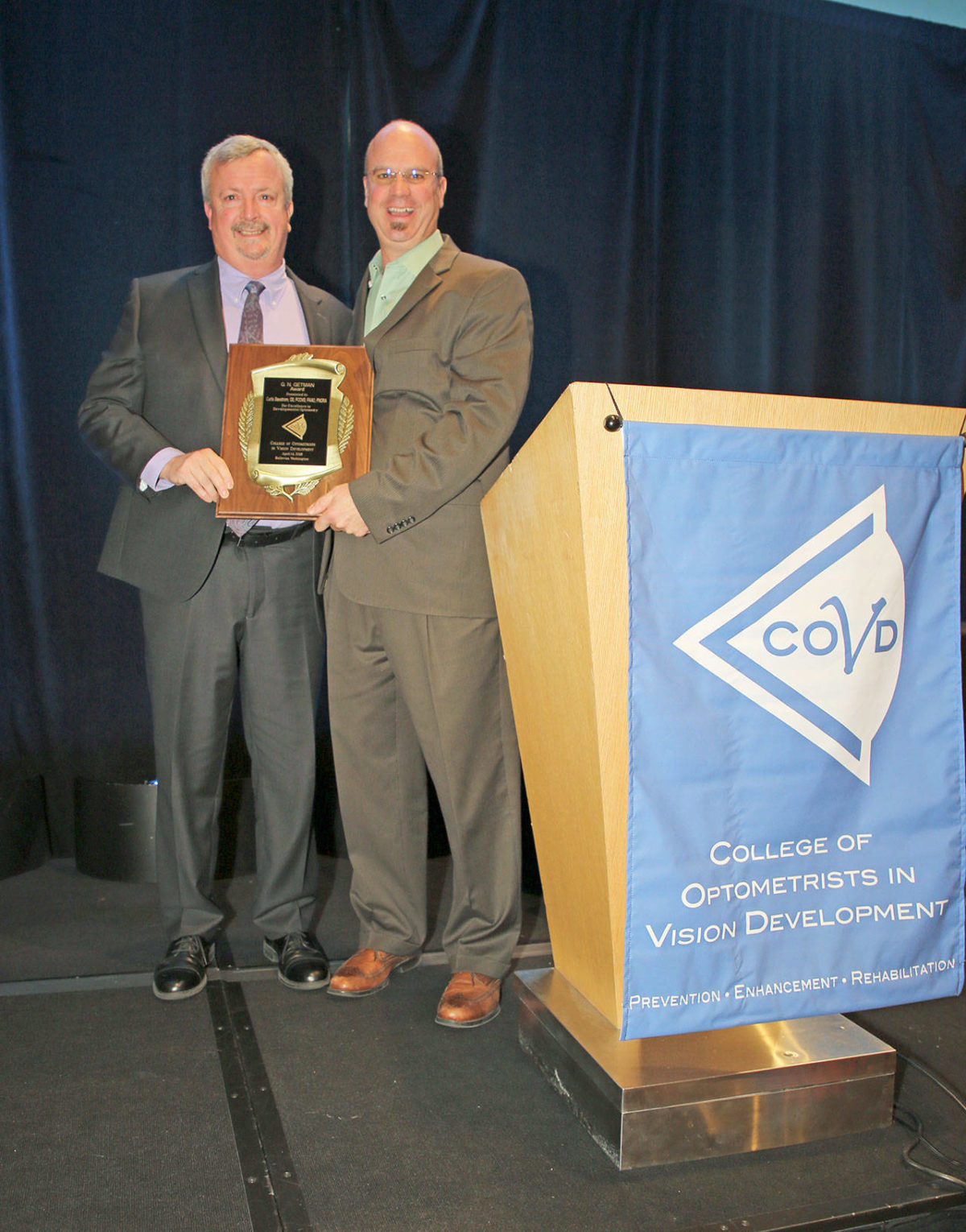 Curtis Baxstrom receiving the G.N. Getman Award