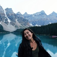 Marika Marx, Outdoor Pursuits Instructor, posing in front of Moraine Lake