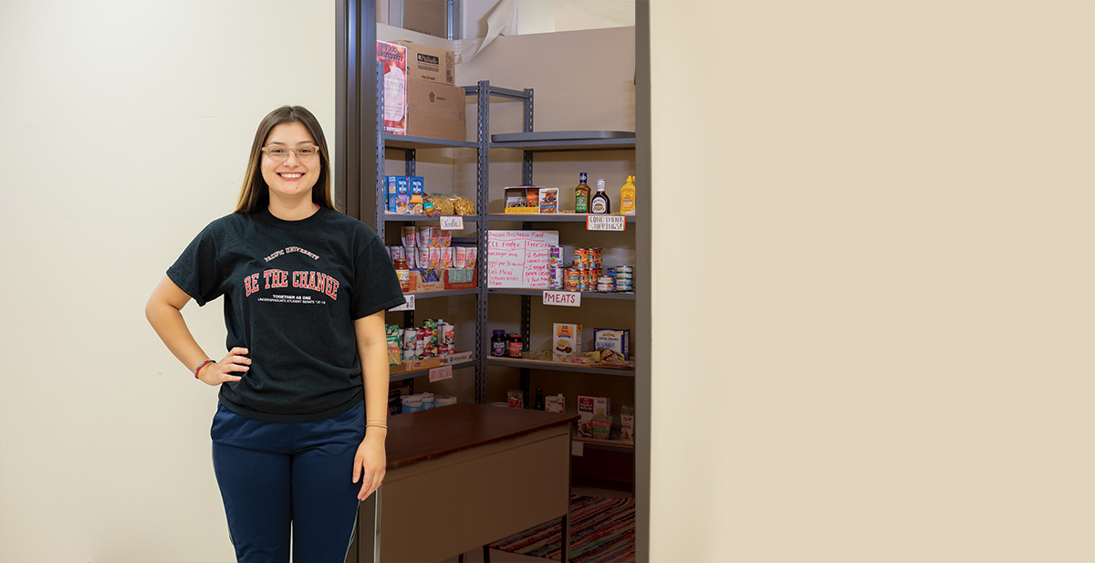 Ruth Gomez '19, Stands in front of the Boxer Food Share