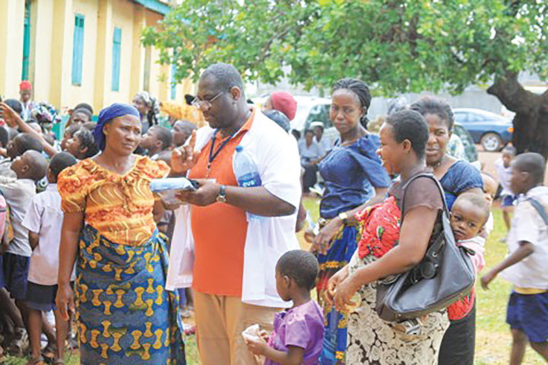 Dr. Agbo Conducting work within a crowd in West Africa