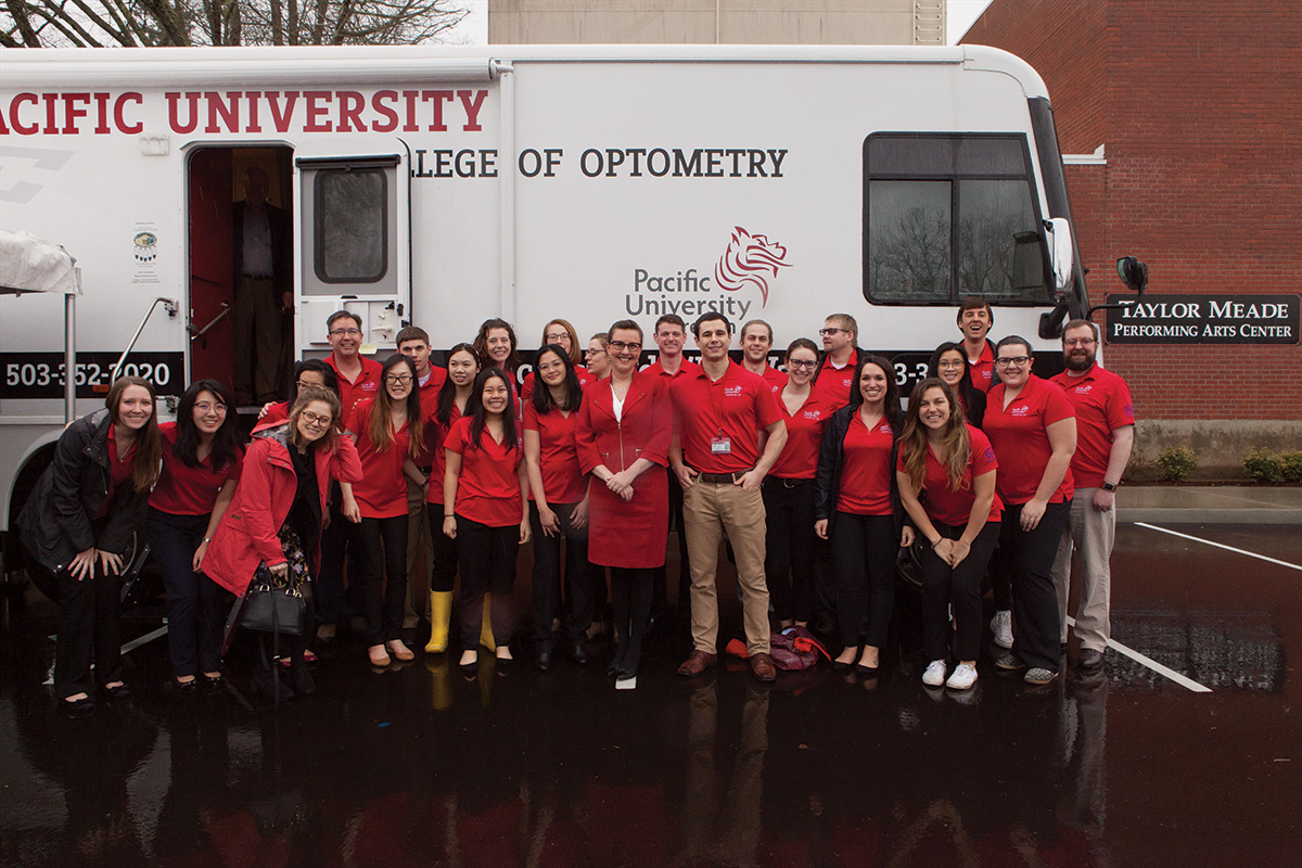 Pacific University Eye Van with Students Posing in Front