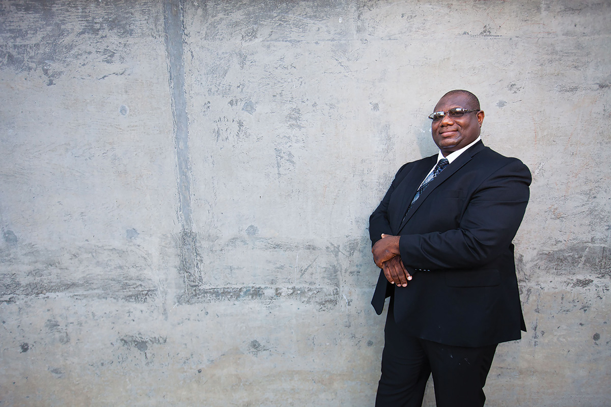 Dr. Peter Agbo, Posing in front of concrete wall