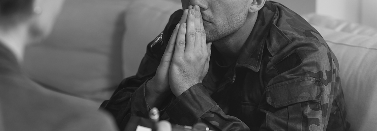Man praying in a black and white photo
