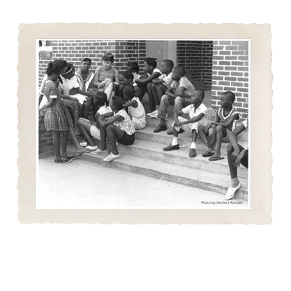 children seated outside