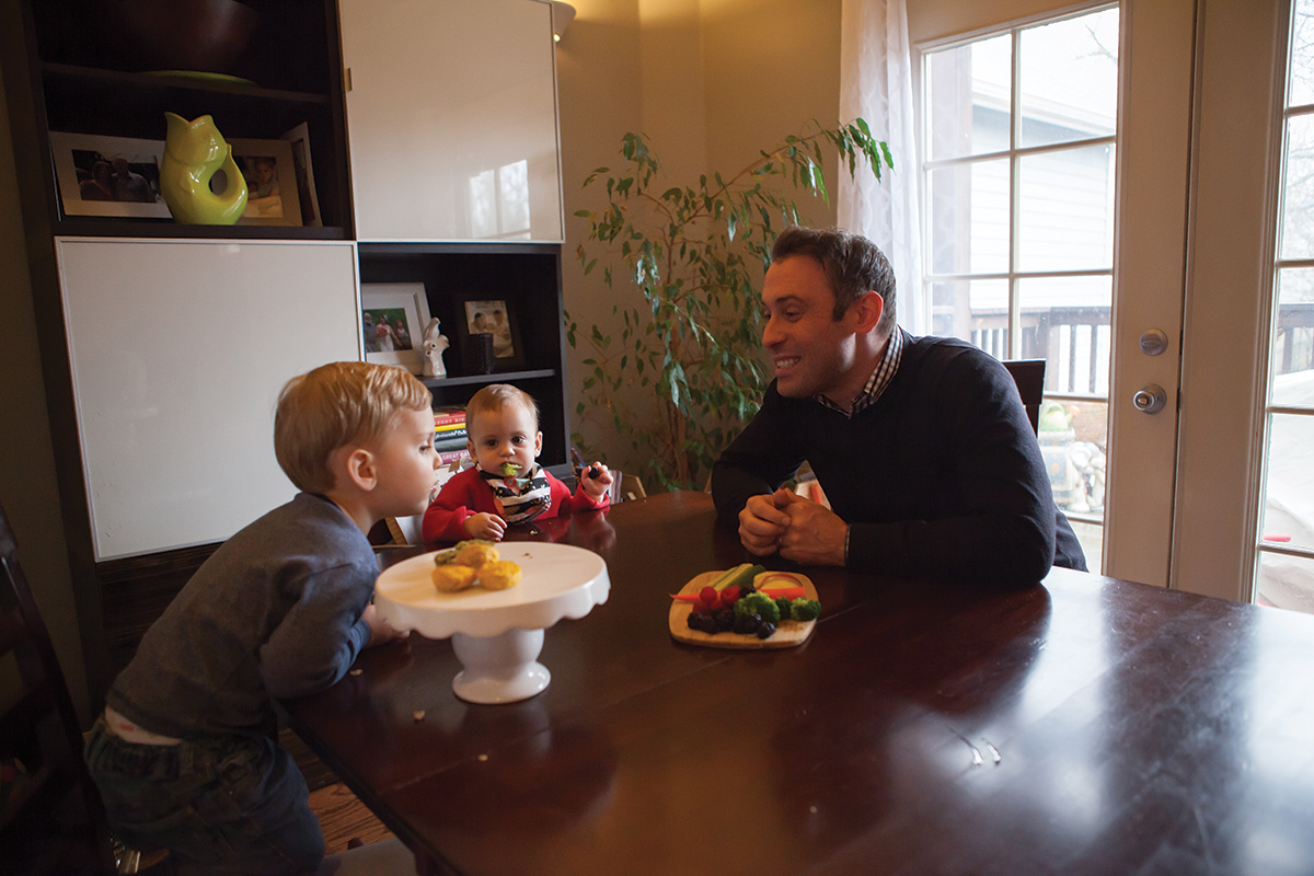 Dustin pictured with younger children eating the snacks.