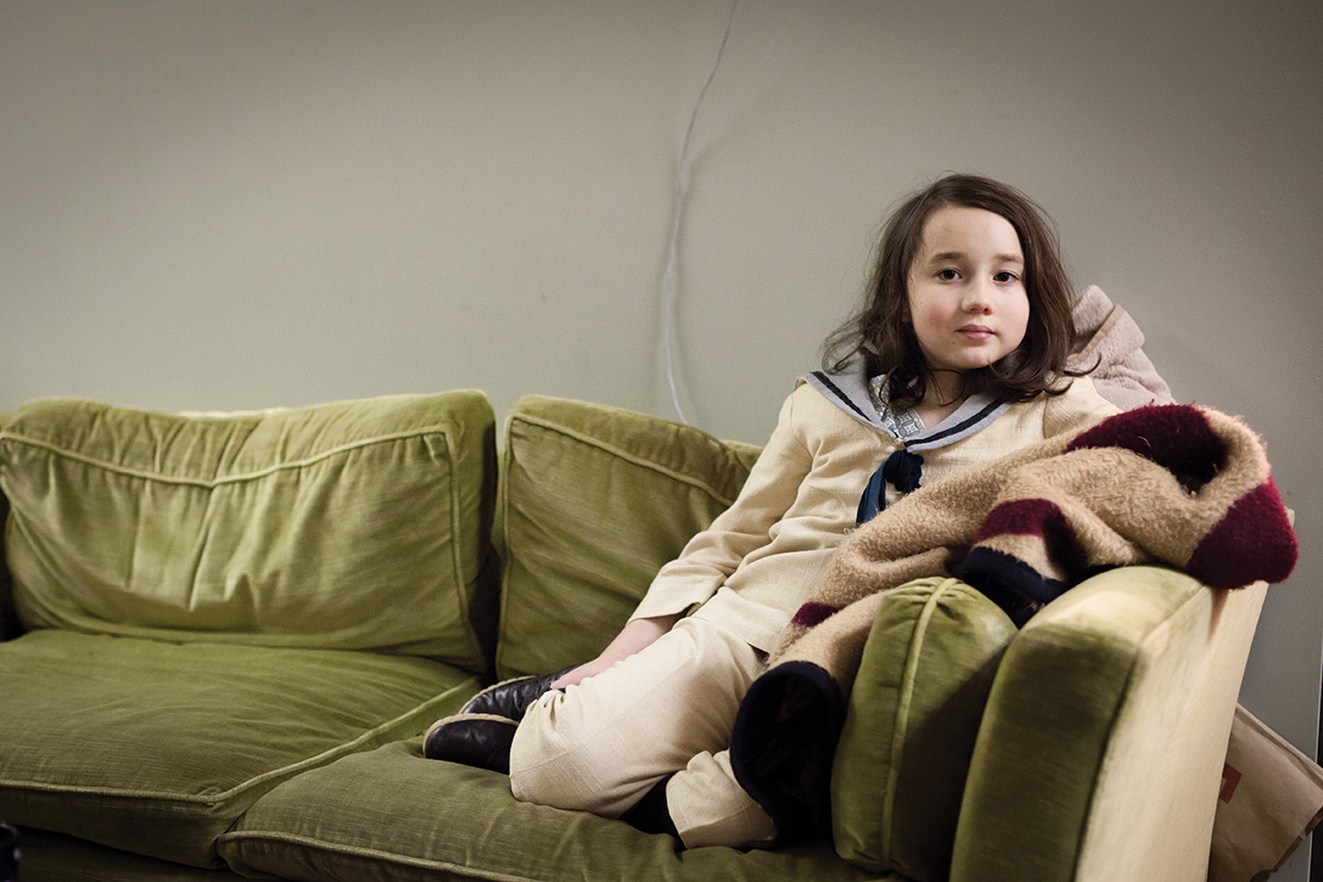Young female seated on the couch