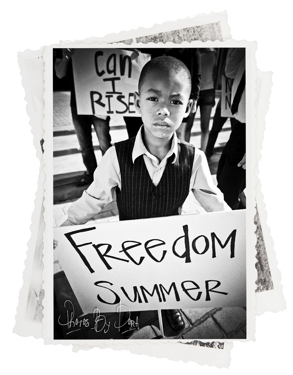 Young boy holding banner up.