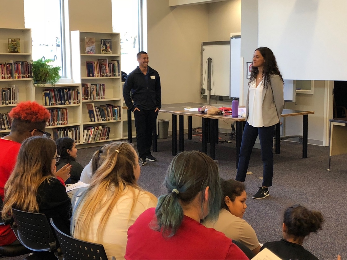 Pictured above from left to right is Bryan Llantero ('20) and Rachel Herron ('20) speaking with students in the AVID program at Conestoga Middle School in Beaverton.