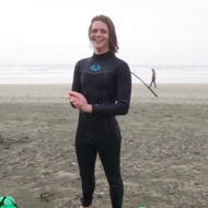 Aidan Carmody, Outdoor Pursuits Instructor, surfing on the Oregon Coast