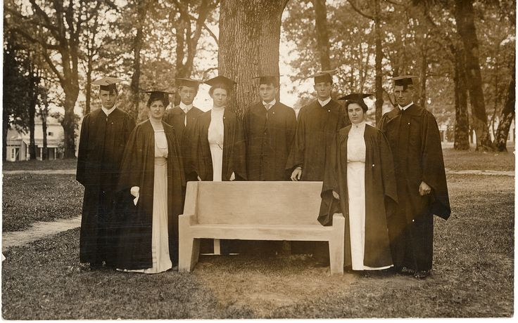 Students gathered around the Spirit Bench in 1908.