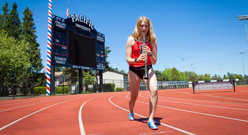 Serena Wallace plays her clarinet on the track
