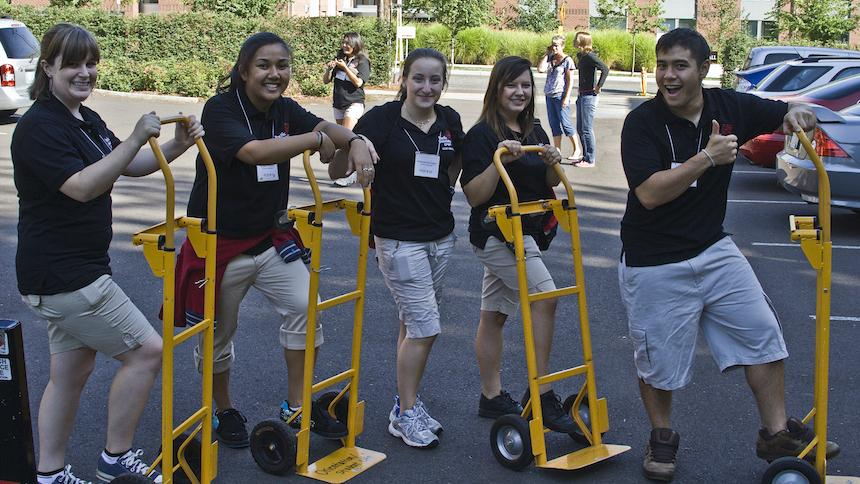 Students with dolly trucks