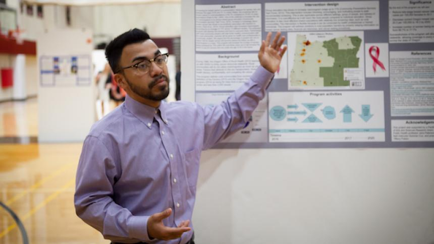 Senior presents posterboard project research
