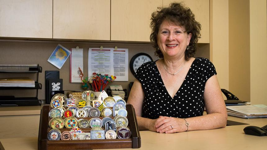 Carol Rymer OD '92 in her Pacific University office