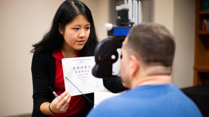 Student conducting an eye exam