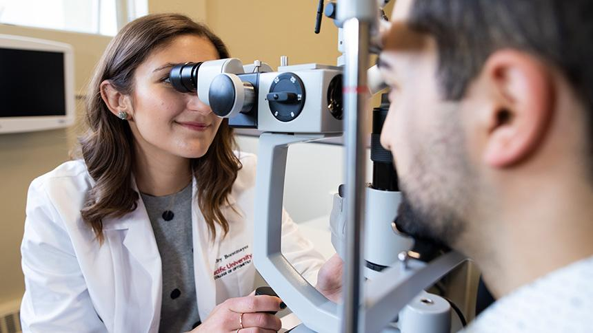 Optometry student practicing an exam