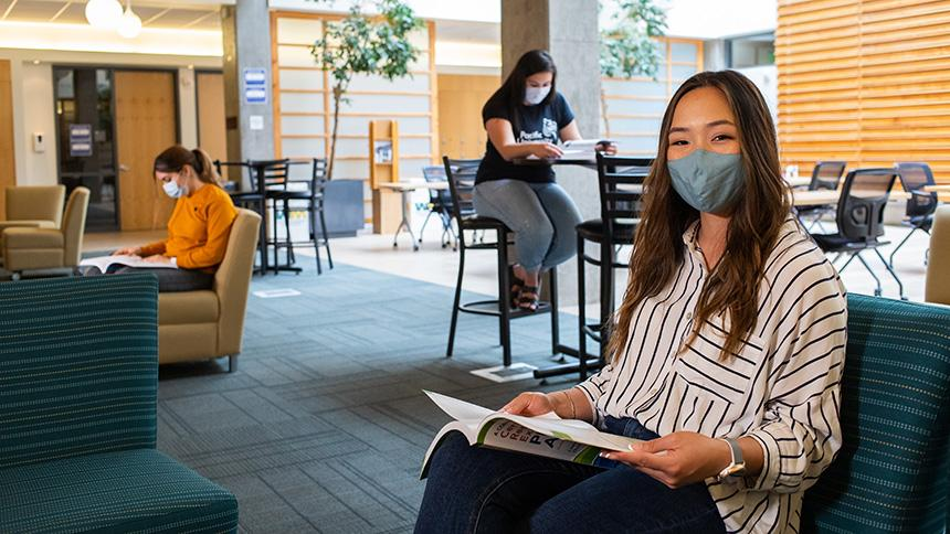 Savannah Tran PA '22 wears a face mask while studying at the Hillsboro Campus