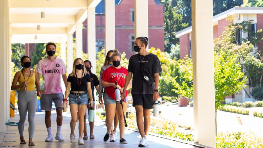 Students with mask walking on campus