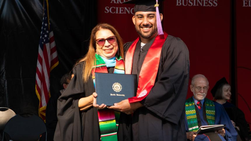 Javier Barron receives award at August commencement