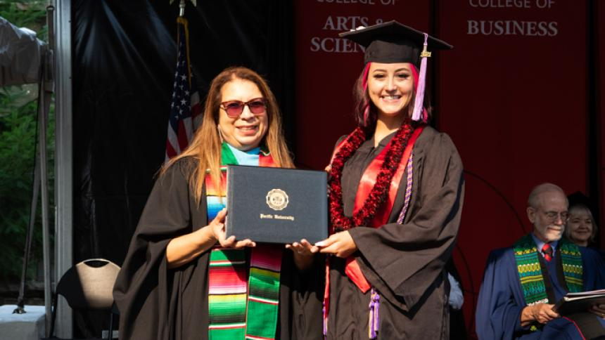Destyne Johnson receives award at August Commencement