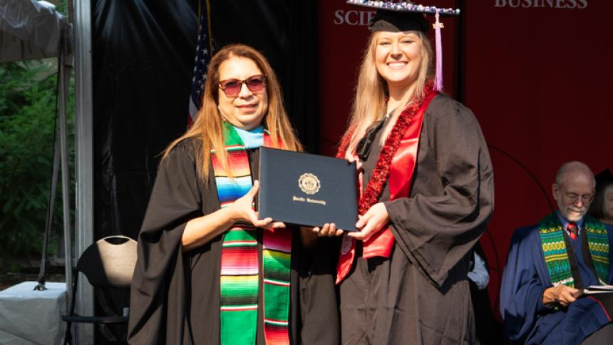 Simonne Lighthouse receives award at August commencement