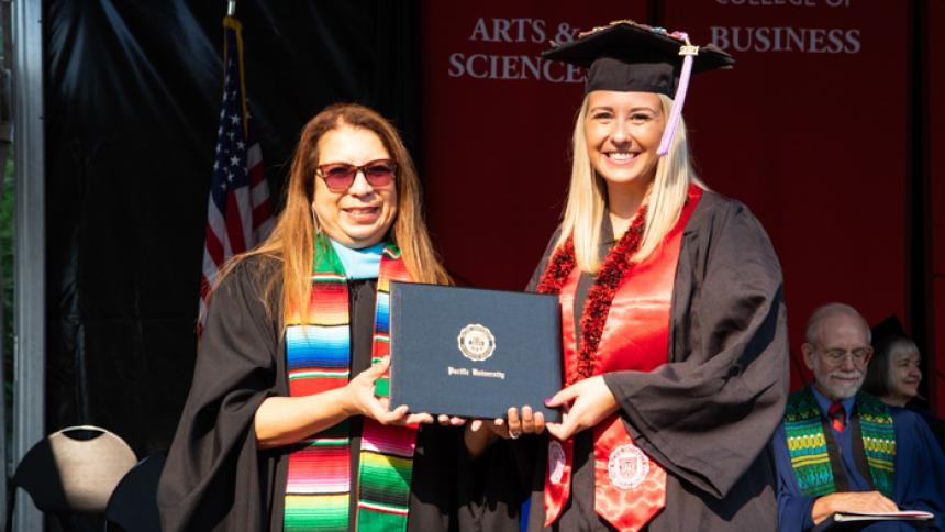 Amanda Musgrave receives award at August commencement