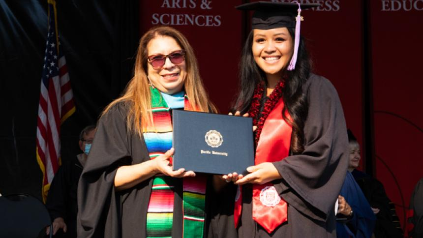 Fiona Phetnouvong receives award at August commencement