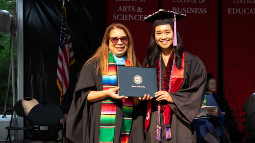 Bethany Rivera receives award at August commencement