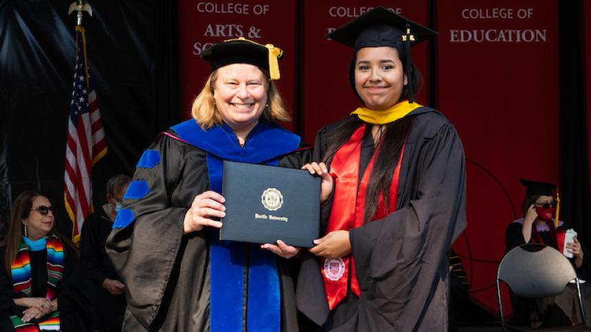 Diana Vazquez receives award at August commencement