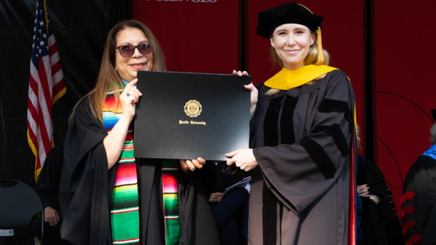 Æx Barr receives award at August commencement