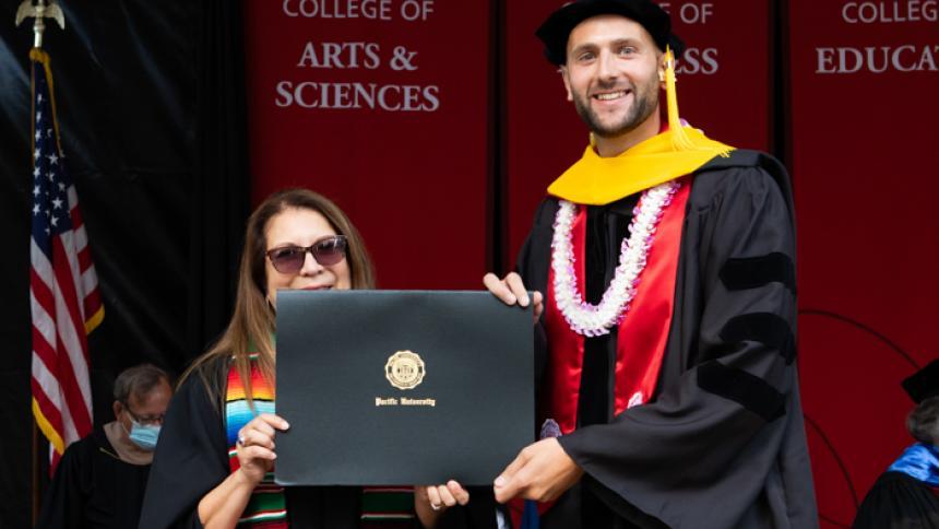 Bradley Schultz receives award at August commencement