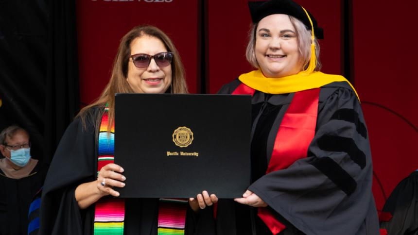 Molly Young receives award at August commencement