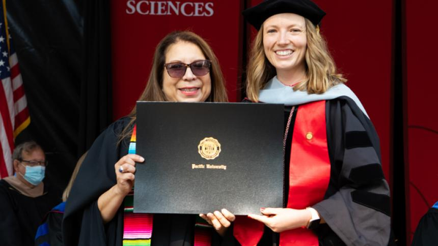 Kelsey Koll receives award at August commencement