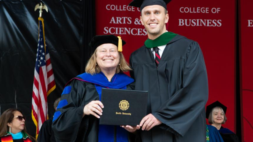 Andrew Campbell receives award at August commencement