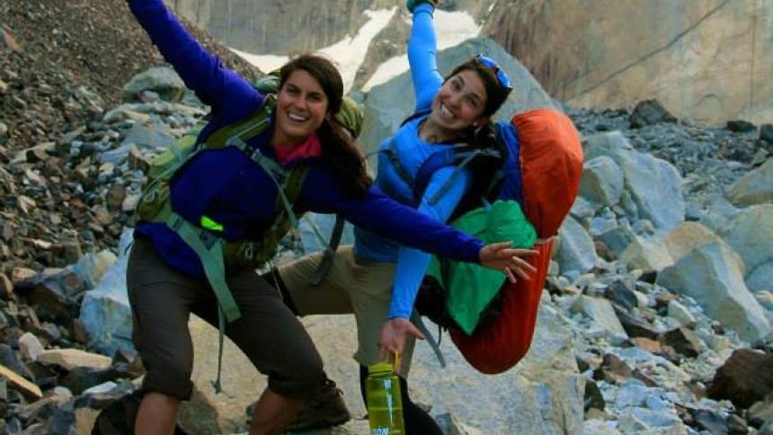 Two hikers exclaim over a climb in Chilean Patagonia