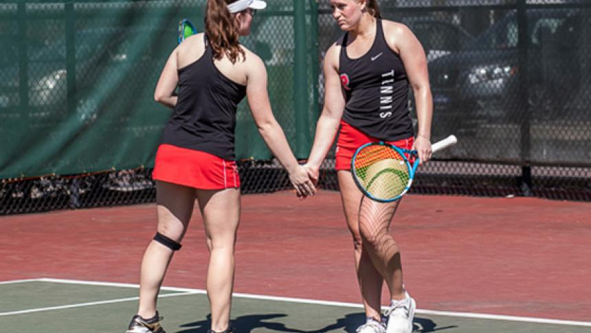 Cassidy & Syndie Binder high-fiving on the tennis court