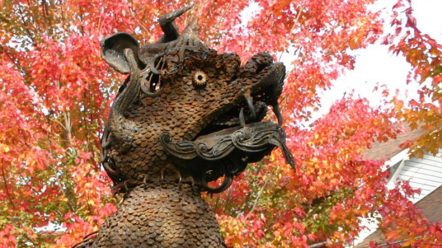Boxer statue in front of fall leaves