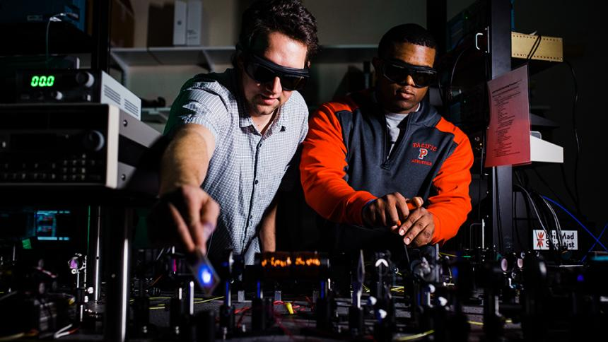 Professor Andy Dawes & Kevin McGee '18 in the laser lab at Pacific